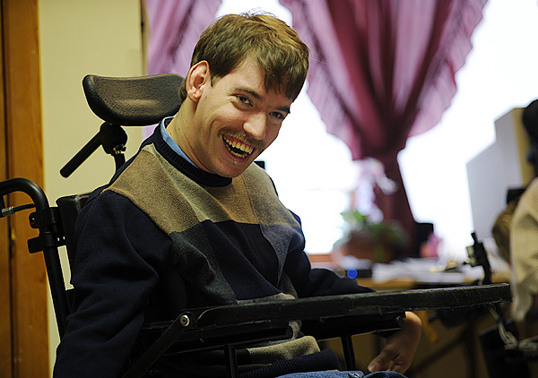 Jake Van Meter smiles during an interview at Penobscot Nursing Home on Saturday, December 26, 2009. Van Meter and fellow nursing home resident, Eric Reeves are suing the state because their only living option is the nursing home. They both contend that living amidst people who are at the end stage of life is depressing for them. (Bangor Daily News/Kevin Bennett)