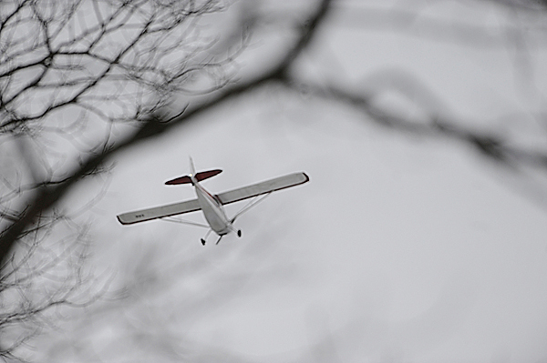 A search plane flies over Route 2 in Greenbush as it circles Olamon Island  as public safety officials reached the downed Cessna which crashed on the island Monday morning, Janaury 4, 2010. BANGOR DAILY NEWS PHOTO BY JOHN CLARKE RUSS