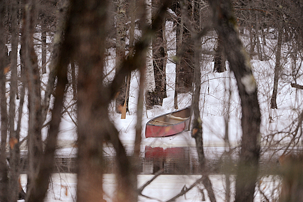 Viewed from  Route 2 in Greenbush, local rescuers brought this red canoe to Olamon Island Monday morning where just an hour or so earlier a Cessna crashed. BANGOR DAILY NEWS PHOTO BY JOHN CLARKE RUSS