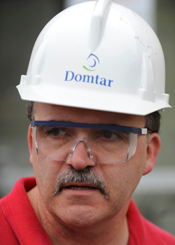 Scott Beal, Domtar company spokesman,  arrives for work at Domtar's Baileyville mill after daybreak Wednesday, June 24, 2009. Employees returned to work Monday after the mill had been idled since May 5, 2009. BANGOR DAILY NEWS PHOTO BY JOHN CLARKE RUSS