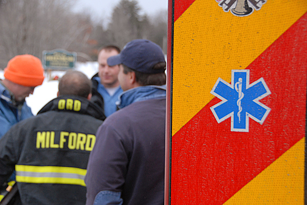 Local firefighters and others confer at a staging area at the insection of Military Road and the Main Road ( Rt. 2) in Greenbush as fellow public safety officials reached the downed Cessna which crashed on Olamon Island Monday morning, Janaury 4, 2010. BANGOR DAILY NEWS PHOTO BY JOHN CLARKE RUSS