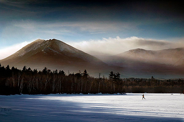 BIG SKI COUNTRY   Ken Spalding of Wayne explores Katahdin Lake as storm clouds clear over mile-high Mount Katahdin on Monday in Baxter State Park. The lake is part of a 4,000-acre parcel of land that was added to the park in December after a $14 million private fundraising campaign. Spalding was leading a group of skiers that completed a six-day, 53-mile traverse of the park on Tuesday. (AP Photo by Robert F. Bukaty)