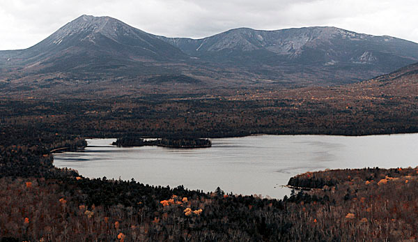 ** ADVANCE FOR MONDAY, JAN. 4 ** In this Oct. 16, 2006 aerial photo,  clouds hover over  Mt. Katahdin by Lake Katahdin, near  T3 R8,  Maine. In 2003 about 6 percent of Maine's total acreage was set aside from development and now the total is  just shy of 18 percent that is set aside for public recreational use.(AP Photo/Pat Wellenbach)