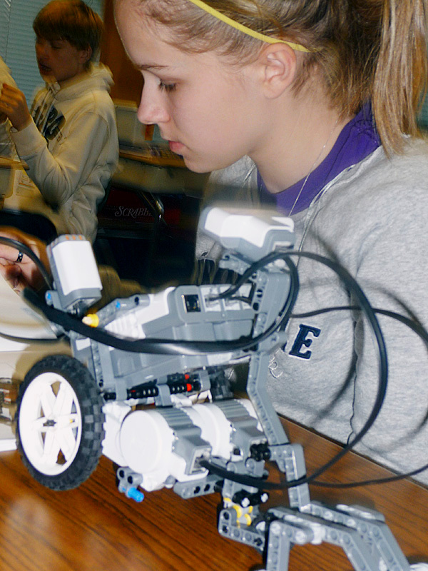 Whitney Porter, 13, of Culter, works on her robot as part of Bay Ridge Elementary School Robotics Club at Cutler. Teams of fifth through eighth graders build robots from kits donated through the Perloff Family Foundation and compete in various tasks. Tuesday's competition involved propelling a ball down the hallway of the school. &quotThey are learning teamwork, direction and cooperation,'' said teacher Wanda Cates. BANGOR DAILY NEWS PHOTO BY SHARON KILEY MACK