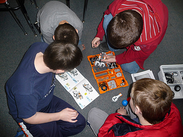 Four fifth and sixth grade boys at Bay Ridge Elementary School in Cutler combine their skills and knowledge to build a robot that will propel a ball down the school's hallway. The robotic kits are donated by the Perloff Family Foundation, which has placed kits in nearly every elementary school in Washington County.  &quotWe have 30 programs under way in Maine and four in New Brunswick,'' Sandra Perloff said Tuesday. Sandra and David Perloff, who live in California and Kennebunkport, visit each program twice a year and they spent Tuesday morning at Cutler. &quotThey don't know it but these kids are actually learning the process of thinking,'' teacher Wayne Peters said. BANGOR DAILY NEWS PHOTO BY SHARON KILEY MACK