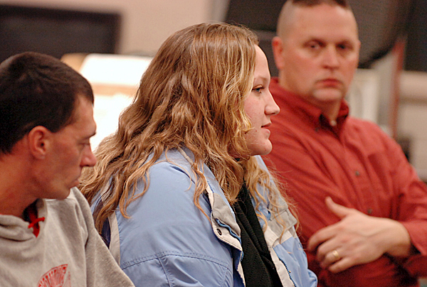 Jocelyn Storey recounts at a Baileyville School Board Meeting how her daughter Jaiden McPhee, 5, had been dropped off by the school bus at the incorrect location on eight different occasions Tuesday, Jan. 5, 2010 at Woodland High School.  Jaiden's father John McPhee (left) and Shawn Donahue (right) whose son has also experienced this problem listen. The school board said they have reviewed and made changes to their bus policy for student drop-offs. BANGOR DAILY NEWS PHOTO BY BRIDGET BROWN