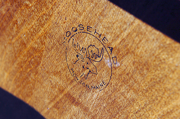 The logo of Moosehead Manufacturing is stamped on each item of furniture the company makes. BANGOR DAILY NEWS PHOTO BY BRIDGET BROWN  (WEB EDITION PHOTO)