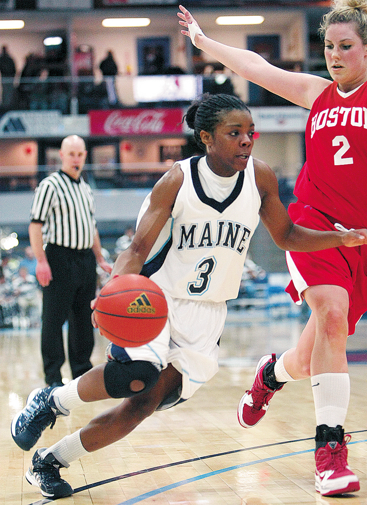 PHOTO: JASON P. SMITH..... University of Maine's Brittany Williams drives past Boston University's Kerry Cashman during their game Tuesday , January 5, 2010 at the University of Maine.