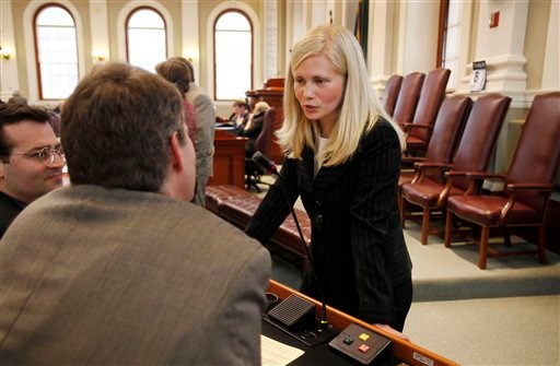 Speaker of the House Hannah Pingree, (D-North Haven) right,  speaks with Rep. John Piotti, (D-Unity), center and Rep. Seth Berry, (D-Bowdoinham), left, Wednesday, Jan. 6, 2009 at the State House in Augusta, Maine. The state budget will be the center of attention during the 2010 election-year session that began Wednesday.  (AP Photo/Joel Page)