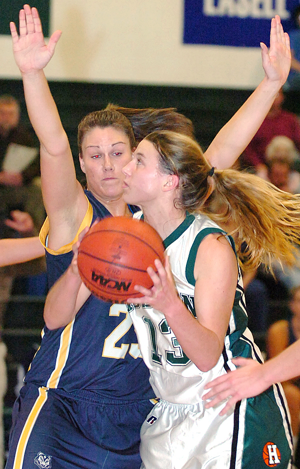 Husson University's Shelby Bradford (right) looks for an opening against University of Southern Maine's Curran Leighton (left) in the first half of Wednesday's game, Jan. 6, 2009 at Newman Gymnasium in Bangor. (Bangor Daily News/Bridget Brown)