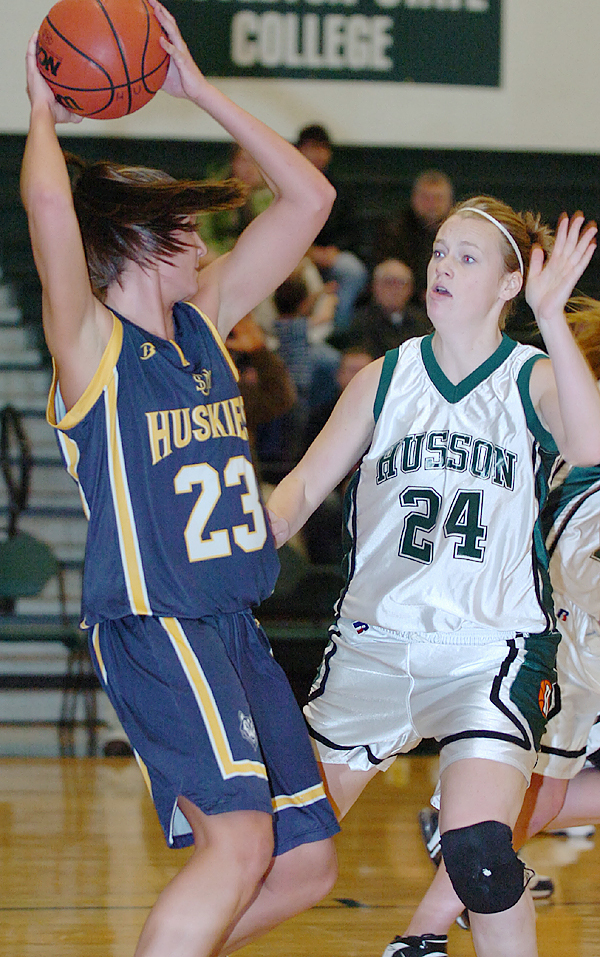 University of Southern Maine's Curran Leighton (left) looks to pass as Husson University's Lindsay Barnes (right) defends in the first half of Wednesday's game, Jan. 6, 2009 at Newman Gymnasium in Bangor. (Bangor Daily News/Bridget Brown)