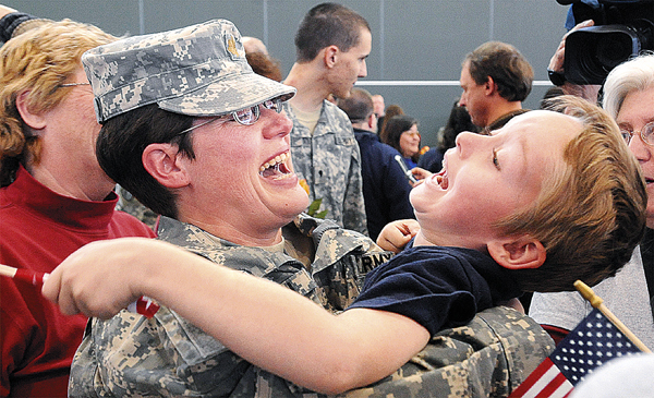 Maj. Lydia Jordan, 42, of Bowdoin shares a laugh with her nephew Eliot Mullen, 6, during the Homecoming Ceremony of the Maine Army National Guard 286th Combat Sustainment Support Batallion in Bangor Wednesday.  Jordan was one of 81 soldiers who returned from a year long deployment to Afghanistan. (Bangor Daily News/Gabor Degre)