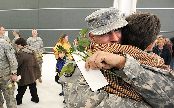 Spc. Josh Sennett of Linneus hugs his son Austin Sennett, 9, during the Homecoming Ceremony of the Maine Army National Guard 286th Combat Sustainment Support Batallion in Bangor Wednesday.  Sennett was one of 81 soldiers who returned from a year long deployment to Afghanistan. (Bangor Daily News/Gabor Degre)