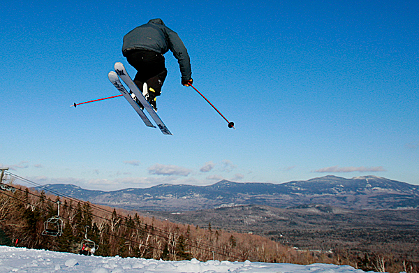 A skier catches some air off a jump on the new Sidewinder Snowboardcross Course at the Sugarloaf ski resort in Carrabassett Valley in 2010.
