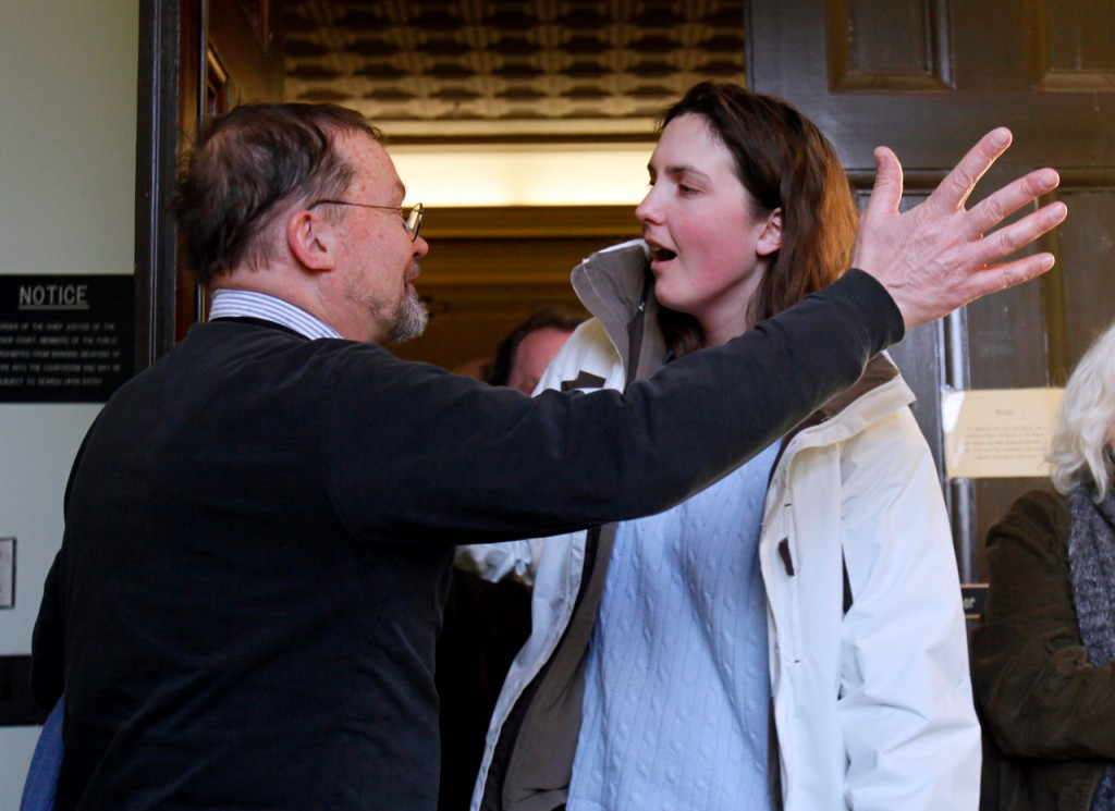 Amber Cummings gets a hug from the Rev. Ken Parker of the First Baptist Church as she leaves Waldo County Superior Court, Thursday in Belfast. Cummings was released after receiving a 8-year suspended sentence for killing her husband after years of physical, emotional and sexual abuse. The killing lead to the discovery of  her husband's Nazi memorabilia, radioactive materials and instructions for building a dirty bomb.