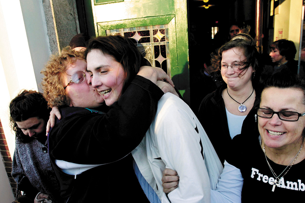 Paula Streubel, left, gives Amber Cummings a hug and a kiss as she leaves the Waldo County Courthouse in Belfast on Thursday, Jan. 7, 2009. Clutching Cummings' arm is her cousin Chary Jopes, right. Cummings received an 8-year suspended sentence in the December 9, 2008 shooting death of her husband, James Cummings, at their High Street home in Belfast. BANGOR DAILY NEWS PHOTO BY KEVIN BENNETT