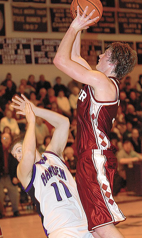 Bangor's Clark Noonan (right) runs into Hampden's Cody Miller (left) on his way to the basket in the second half of Thursday's game, Jan. 7, 2010 in Hampden. BANGOR DAILY NEWS PHOTO BY BRIDGET BROWN