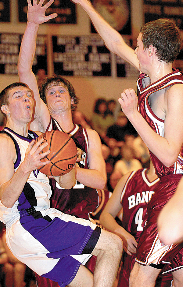 Hampden's Graham Safford (left) goes up for a shot against Bangor's Clark Noonan (center) and Patrick Stewart (right) in the first half of Thursday's game, Jan. 7, 2010 in Hampden.   BANGOR DAILY NEWS PHOTO BY BRIDGET BROWN