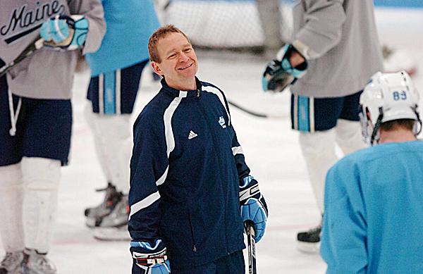 Coach Tim Whitehead talks to Gustav Nyquist (right) during practice Wednesday, Jan. 6, 2010 at the Alfond Arena in Orono. BANGOR DAILY NEWS PHOTO BY BRIDGET BROWN