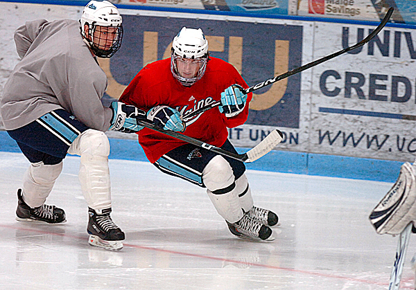 UMaine's Klas Ledermark (right) skates at a practice Wednesday, Jan. 6, 2010 at the Alfond Arena in Orono. BANGOR DAILY NEWS PHOTO BY BRIDGET BROWN
