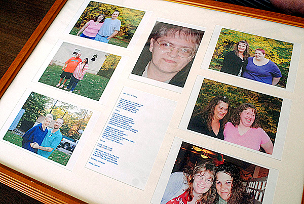 BANGOR, ME -- DECEMBER 31, 2009 -- Lynn Martin of Windham is one of seven children who were adopted as children.  All five sisters have found each other, but the only brother has not been found yet. Lynn has framed photos of the six found siblings.  BANGOR DAILY NEWS PHOTO BY LINDA COAN O'KRESIK