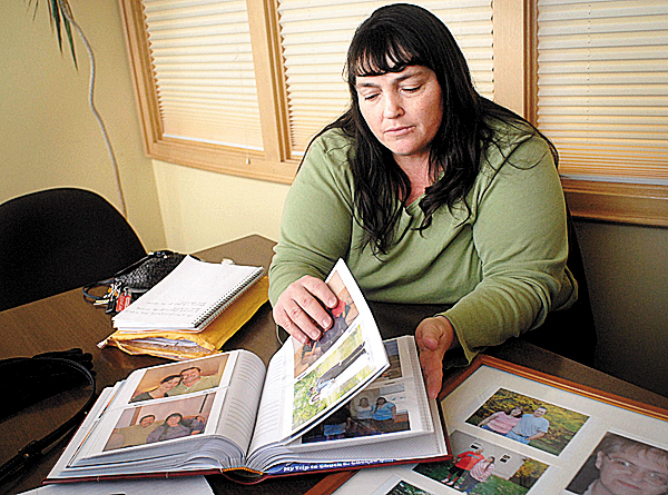 BANGOR, ME -- DECEMBER 31, 2009 -- Lynn Martin of Windham is one of seven children who were adopted as children.  All five sisters have found each other, but the only brother has not been found yet.  BANGOR DAILY NEWS PHOTO BY LINDA COAN O'KRESIK