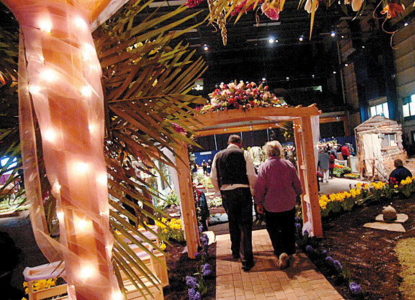 BANGOR GARDEN SHOW   Visitors at the 17th annual Bangor Garden Show walk through a gazebo and arbor display Friday. Created by Black Bear Lawn Care and The Greenhouse, the Gazebo was part of the landscaper's exhibit.   BANGOR DAILY NEWS FILE PHOTO
