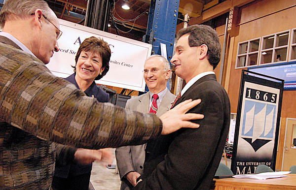 Left to right: Cianbro Corp. President and CEO Peter Vigue, Senator Susan Collins (R-Maine), University of Maine President Robert A. Kennedy and A.E.W.C. director Dr. Habib Dagher huddle at the end of Friday's press conference at the Advanced Structures & Composites Center at the University of Maine in Orono. The group was on hand at the center Friday afternoon, January 8, 2010 to announce the U.S. Dept. of Commerce's $12.5 million Recovery Act grant to construct a new Advanced Nanocomposites in Renewable Energy Laboratory at the the University of Maine's Advanced Structures & Composites Center.   BANGOR DAILY NEWS PHOTO BY JOHN CLARKE RUSS