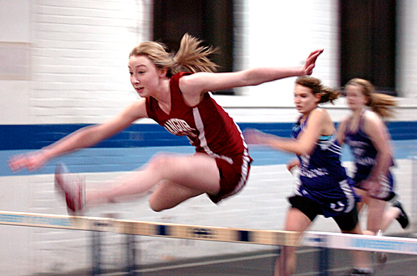 Bangor's Grace Mclean (left) races in a preliminary heat of the girls hurdles during the PVC-Eastern Maine Indoor Track meet Friday, Jan. 8, 2010 at the Field House in Orono. Maclean placed second in the final event behind Ashten Hackett of Edward Little.   BANGOR DAILY NEWS FILE PHOTO BY BRIDGET BROWN