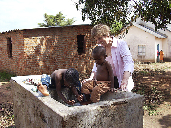 Pastor Ellen Bridge of Peoples United Methodist Church in Newport visits with Zimbabwean orphans who followed her during her mission trip to Zimbabwe in Fall 2009. (photo courtesy of Pastor Ellen Bridge)