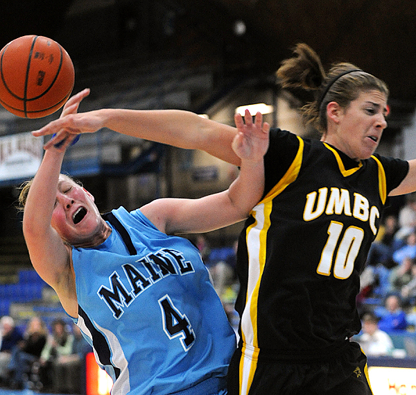 The University of Maine's Kristin Baker (4) is fouled by UMBC's Meghan Colabella during the first half of the game in Orono Sunday. BANGOR DAILY NEWS PHOTO BY GABOR DEGRE