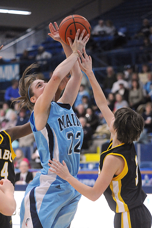 The University of Maine's Samantha Wheeler (left) tries to make a shot over UMBC's Chelsesa Barker during the first half of the game in Orono Sunday. BANGOR DAILY NEWS PHOTO BY GABOR DEGRE