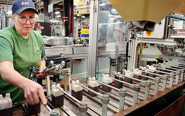 Tammy Robertson, who has been an employee at Brewer Automotive components for 10 years, loads stabilizer links for Toyota Corollas onto a machine to be modified and then shipped to an assembly plant on Thursday. BAC was founded in 1989 and is the sole supplier of steering and suspension components for Toyota in North America. The company has recently partnered with Eastern Maine Community College to offer continuing education and a chance for its employees to work twoard an associate of applied science degree.  (BANGOR DAILY NEWS PHOTO BY BRIDGET BROWN)  CAPTION  Tammy Robertson, who has been an employee at Brewer Automotive Components for 10 years, loads stabilizer links for Toyota Corollas onto a machine to be modified and then shipped to an assembly plant Thursday, Feb. 28, 2008. BAC was founded in 1989 and is the sole supplier of steering and suspension components for Toyota in North America and has recently parterned with Eastern Maine Community College to offer continuing education and a chance for their employees to work towards an Associate of Applied Science degree. (Bangor Daily News/Bridget Brown)