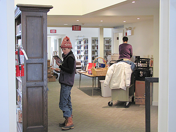 Katrina Saucier of Pittsfield peruses the DVDs available at Pittsfield Public Library on Monday, the first day the library was re-opened since it was closed in early December for a major expansion and renovation project. The $1.5 million project, which was accomplished with grants and donations, is still ongoing in some areas, though Librarian Lyn Smith said the public is now &quotmore than welcome.&quot BANGOR DAILY NEWS PHOTO BY CHRISTOPHER COUSINS.