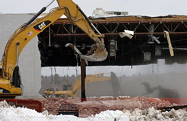 Demolition workers from Sargent Corporation tear down the former Walmart building on Springer Drive in Bangor on Monday, Jan. 11, 2010. The empty lot is expected to be used for a future Lowe's Home Improvement store. BANGOR DAILY NEWS PHOTO BY BRIDGET BROWN