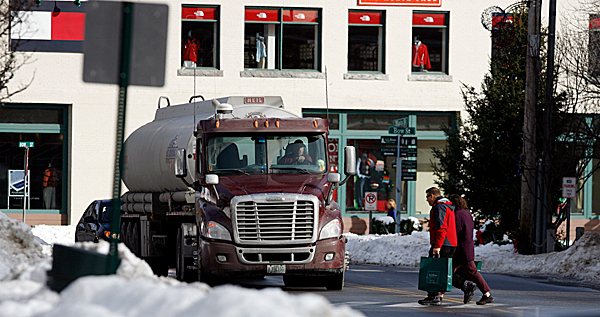 Joe Cormier, a truck driver for H.O. Bouchard Inc., who has traveled through Freeport more than 200 times a year for 15 years with a variety of loads, stops for shoppers as he passes through his former trucking route on Rt. 1 in Freeport, Maine, on Monday, Jan. 4, 2010.  Heavy trucks used to creep through town,  because they weren't allowed on Interstate 295 a quarter-mile away. But most of the trucks have disappeared,  with the passage of a new law that allows heavier trucks, weighing 100,000 pounds ,to use interstate highways in Maine.Those 50-ton behemoths no longer have to dodge tourists and shoppers crossing busy Freeport's Main Street since President Barack Obama signed a measure Dec. 16 allowing the heavy trucks on Maine's interstates. A similar one-year pilot program was approved in Vermont, as well.  (AP Photo/Pat Wellenbach) .(AP Photo/Pat Wellenbach)