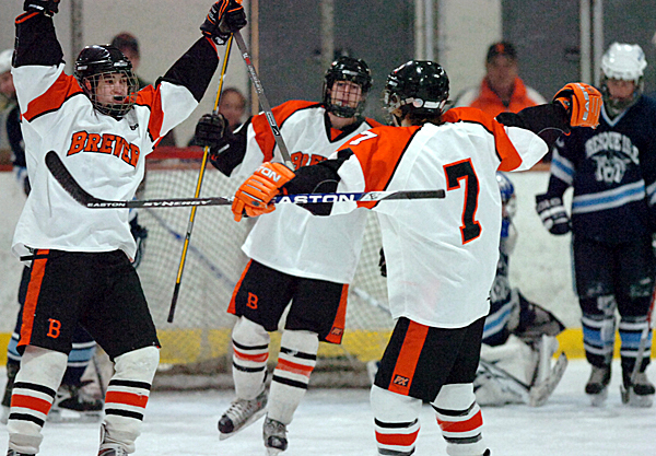 Brewer's Tyler White (from left), Evan Nadeau and Jake Valley celebrate the Witches' eighth goal of the evening against Presque Isle with just over a minute left in the second period of Monday's game, Jan. 11, 2010 at Penobscot Arena in Brewer. Brewer won 10-5. BANGOR DAILY NEWS PHOTO BY BRIDGET BROWN