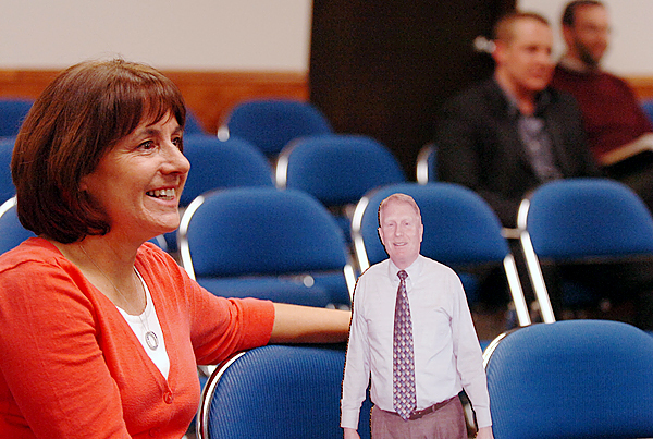 Bonnie Farrar sits with a cardboard likeness of her husband, Robert Farrar, at Monday's Bangor City Council meeting Jan. 11, 2010, during which he was appointed as the Interim City Manager. Chairman Richard Stone gave her the cutout in reference to the long hours Farrar will working in his new position. (Bangor Daily News/Bridget Brown)