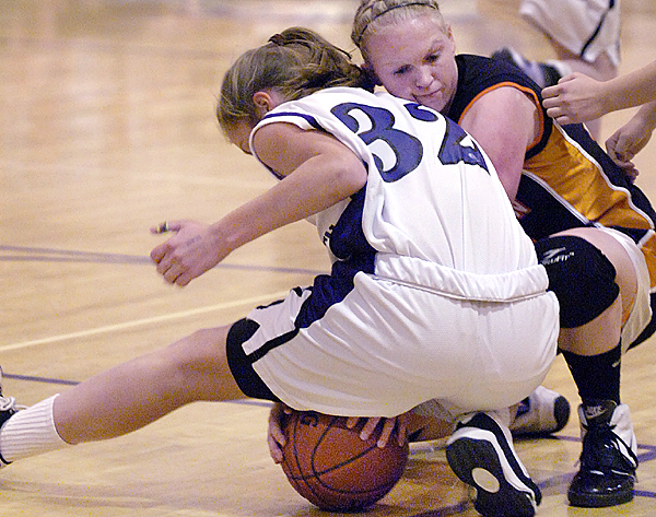 Hampden's Sarah Lamberton (left) and Skowhegan's Whitney Jones fight over a loose ball in the first half of Tuesday's game, Jan. 12, 2010 at Hampden Academy. (Bangor Daily News/Bridget Brown)