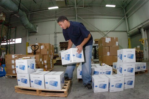 Robert Morales organizes medical supplies at the Americares warehouse as part of the aid the organization will send to Haiti following Tuesday's earthquake, Wednesday, Jan. 13, 2010 in Stamford, Conn. (AP Photo/The Hour, Erik Trautmann)