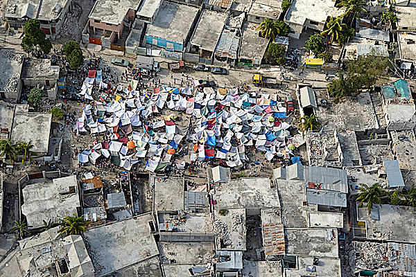 In this photo released by the United Nations, earthquake survivors' tents are seen between buildings in Port au Prince, Haiti, Wednesday, Jan. 13, 2010.  A 7.0-magnitude earthquake struck Haiti Tuesday.  AP PHOTO / UNITED NATIONS/ LOGAN ABASSI