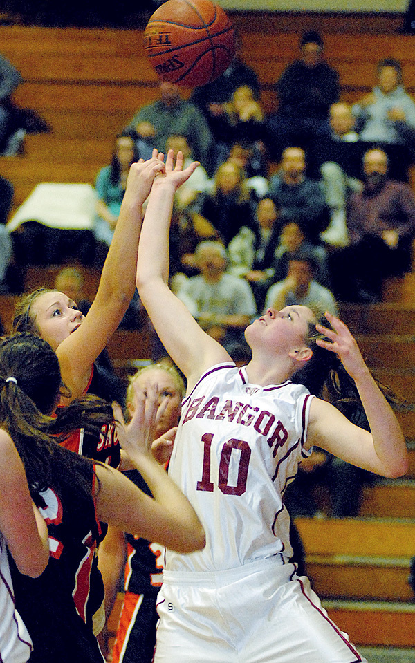 BANGOR, ME -- JANUARY 14, 2010 -- Bangor's Hillary Throckmorton and Skowhegan's Amanda Johnson go up for a rebound in the first half of Friday nights game at Bangor.