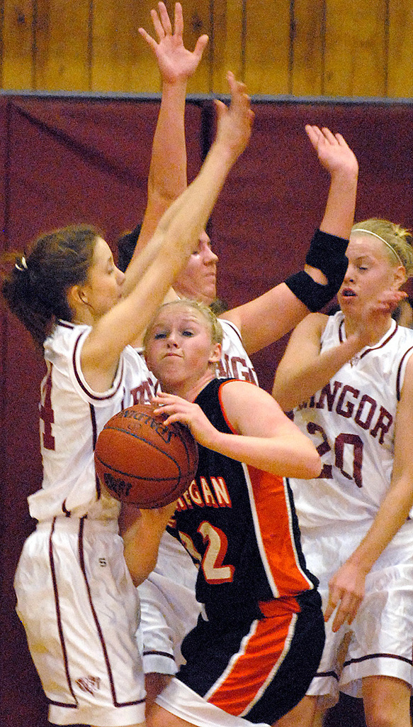 BANGOR, ME -- JANUARY 14, 2010 -- Skowhegan's Whitney Jones is flanked by Bangor defenders Breianna Tocci, Stephanie Comstock and Kim Jordan (left to right) in the first half of Friday nights game at Bangor.