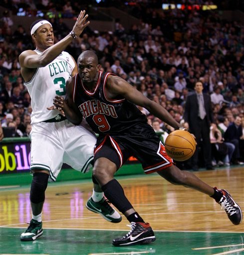 Chicago Bulls forward Luol Deng, right, drives to the basket against Boston Celtics forward Paul Pierce during the second half of their NBA basketball game in Boston, Thursday, Jan. 14, 2010. Deng had 25 points as the Bulls defeated the Celtics 96-83. (AP Photo/Charles Krupa)