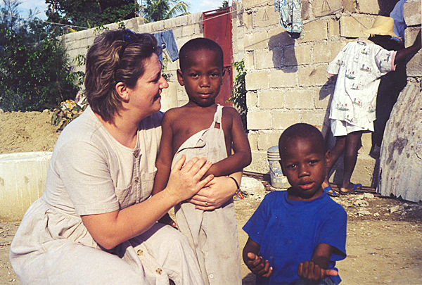 Claudette Babin of the Celebration Center in Fort Fairfield is seen in a 2005 photo with nephews of the pastor of the center's sister church in Vignier, Haiti.  PHOTO COURTESY OF MARK BABIN