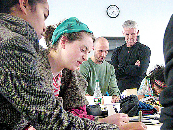 Belfast-based designer John Bielenberg, at right, observes as College of the Atlantic students Jane Nurse, Mollie Bedick and Ross Pike (from left to right) participate in a creative design session Saturday at the college. The session was part of a two-day design blitz led by Bielenberg at COA to teach students how to channel their creativity into ideas for addressing social and logistical challenges.  BANGOR DAILY NEWS PHOTO BY BILL TROTTER