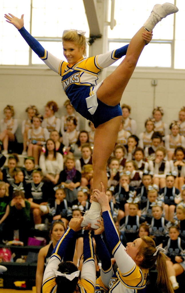 OLD TOWN, ME -- JANUARY 16, 2010 -- Kelsey Small holds a scale during Hermon's routine at the Big East Cheering Competition at Old Town High School on Saturday.  The Hermon Hawks took first place.