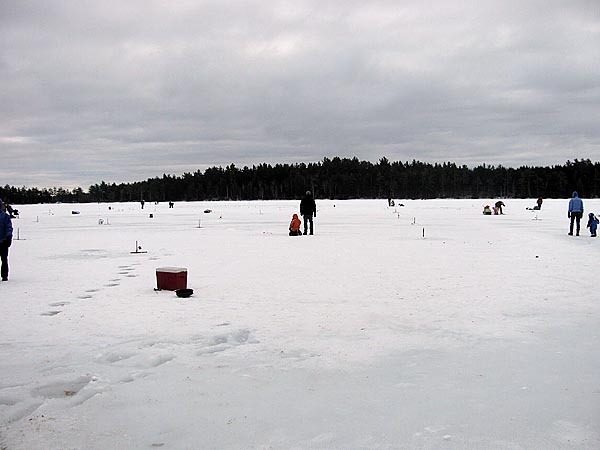 Lake St. George was dotted Sunday by clusters of ice fishermen taking part in the youth ice fishing derby. BANGOR DAILY NEWS PHOTO BY ABIGAIL CURTIS