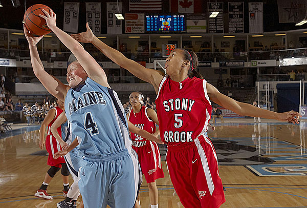 Maine's Kristin Baker, (4), keeps the ball away from Stony Brook's Gerda Gatling, (5), in the first half of their game in Orono , Sat., Jan. 16, 2010. BANGOR DAILY NEWS PHOTO BY MICHAEL C. YORK