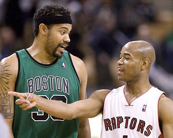 Toronto Raptors guard Jarrett Jack, right, and Boston Celtics forward Rasheed Wallace share a laugh at the end of the Celtics' win over the Raptors in NBA basketball game action in Toronto on Sunday, Jan. 10, 2010. (AP Photo/The Canadian Press,Frank Gunn)